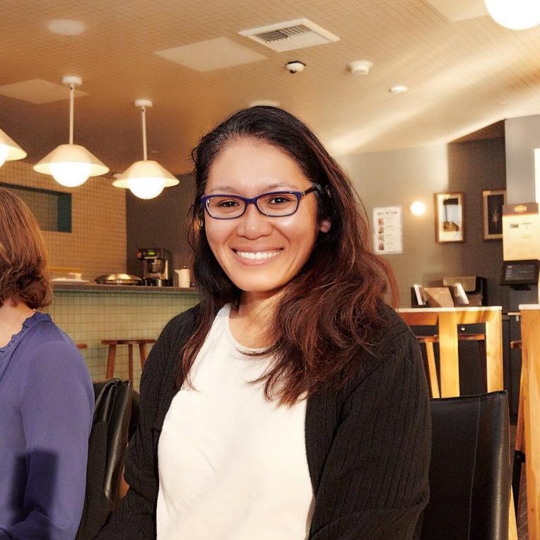 Lana Lee Sitting at a Meetup